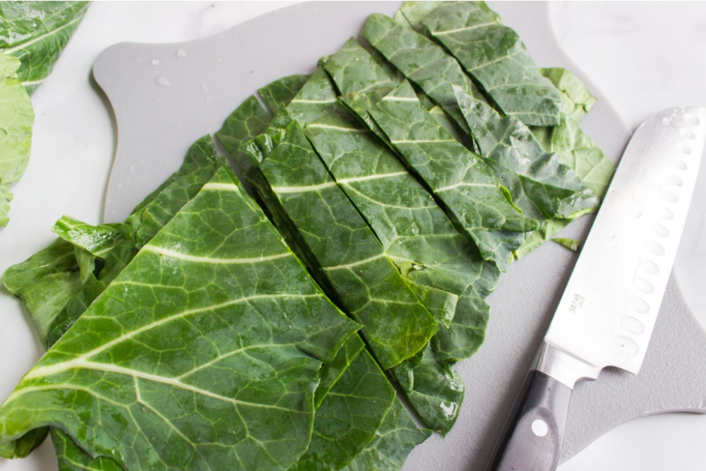 collard greens sliced on a cutting board