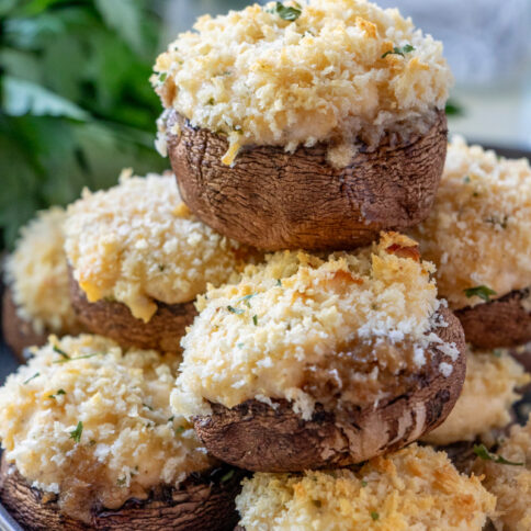 Crab stuffed Mushrooms stacked on a plate
