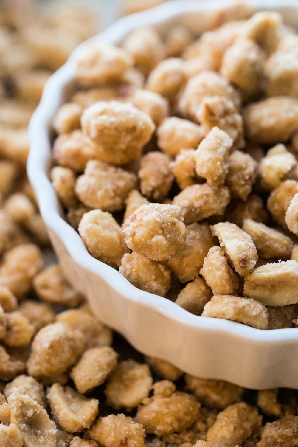 candied peanuts in a white bowl
