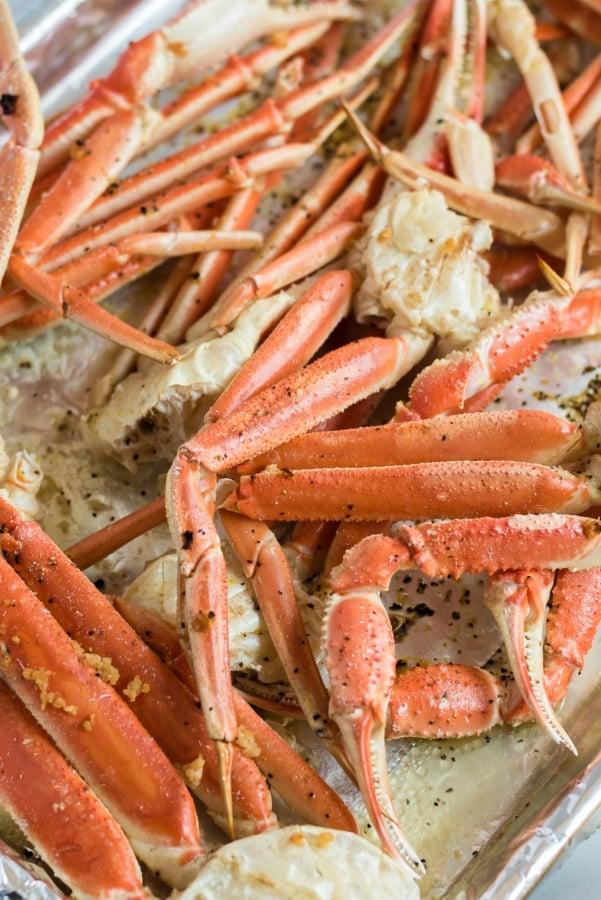 crab legs on a baking sheet