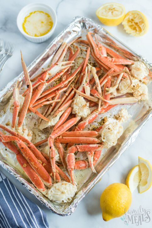 crab leg clusters on a baking sheet