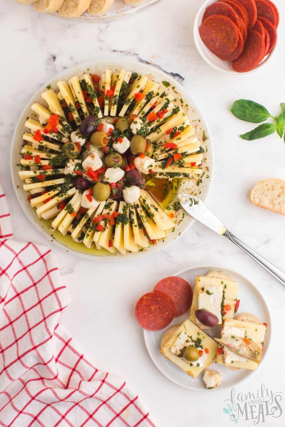 This marinated cheese ring is such an easy and fun way to add a bit of decorative snacking to your holiday appetizer table! via @familyfresh