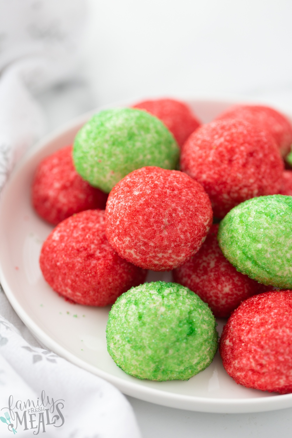 Red and Green Butter Cookies stacked on a plate