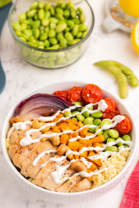 Chicken Buddha Bowl drizzled with a white sauce