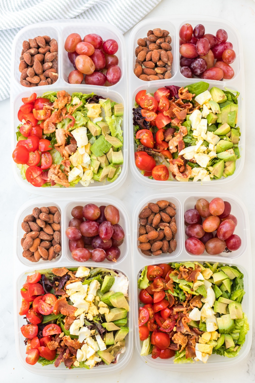 top down of 4 cobb salad lunch boxes