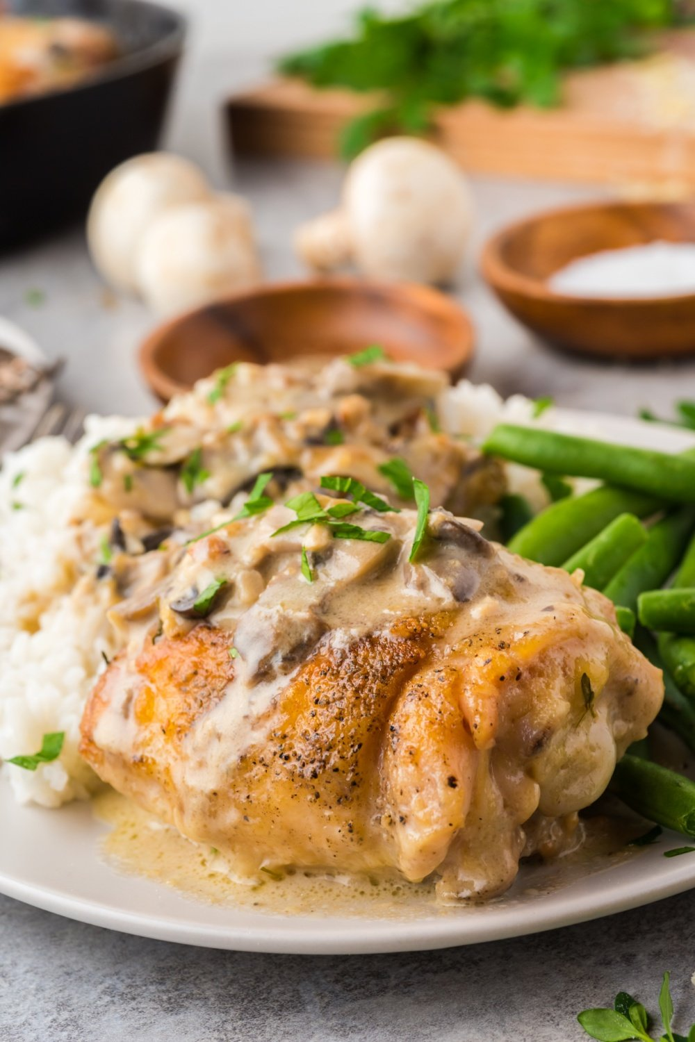 This Creamy Mushroom Chicken Thighs Skillet packs all the rich flavors of cream, mushroom, garlic and cheese resulting in a family favorite recipe that will come together within 40 minutes! via @familyfresh