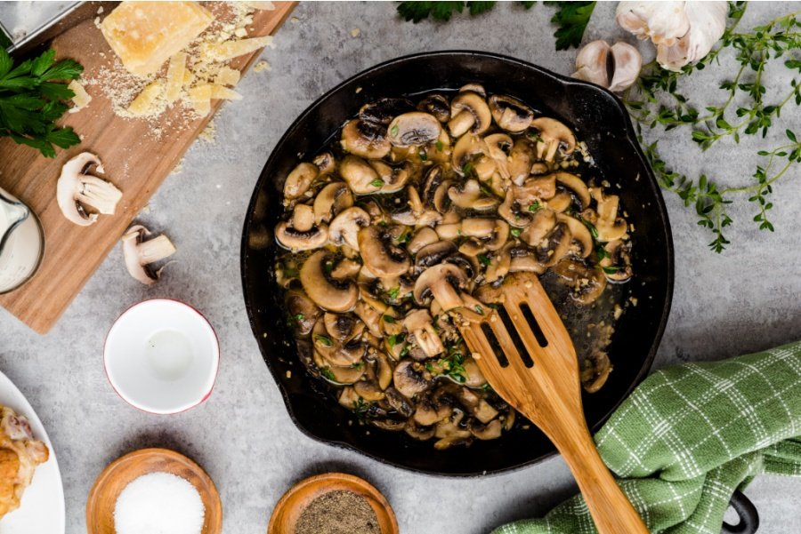 mushrooms cooking in cast iron pan