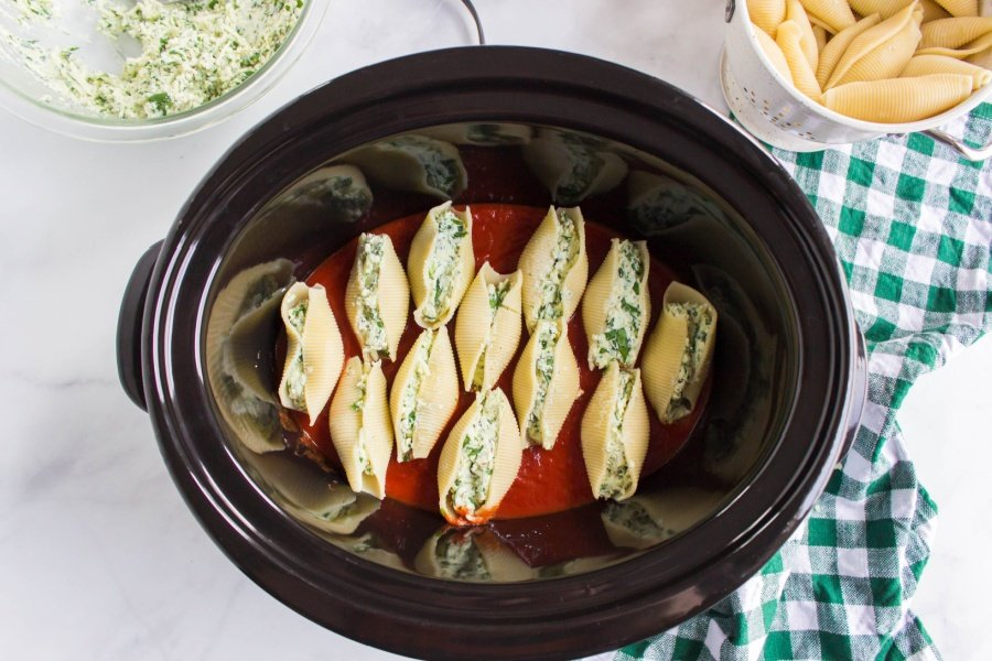 stuffed shells place in crockpot on top of red sauce