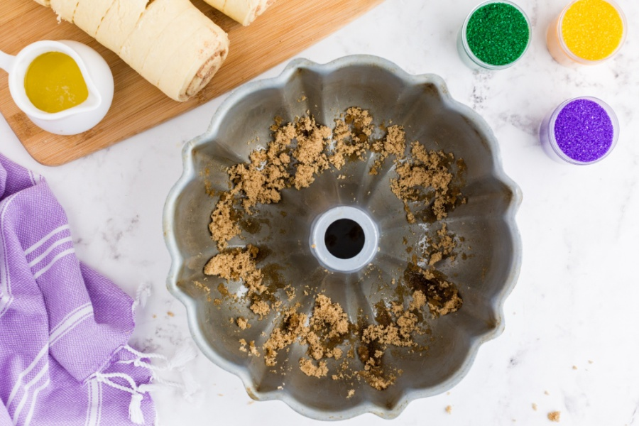 melted butter and brown sugar in the bottom of a bundt cake