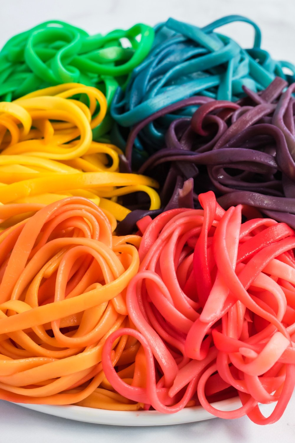 These colorful Rainbow Pasta Noodles turn any pasta dish into a real work of art. Even plain old spaghetti becomes magical! via @familyfresh