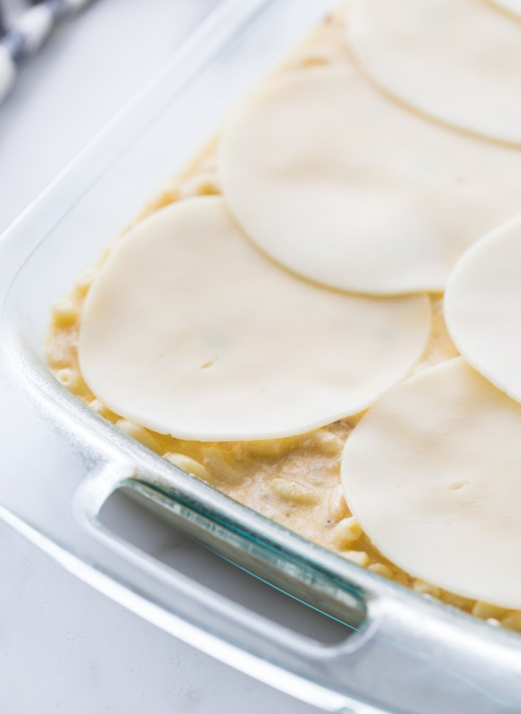 sliced cheese placed on top of casserole