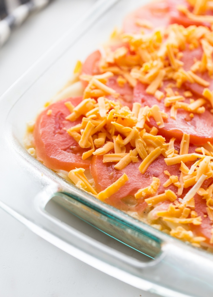 sliced tomatoes and shredded cheese added to top of the casserole
