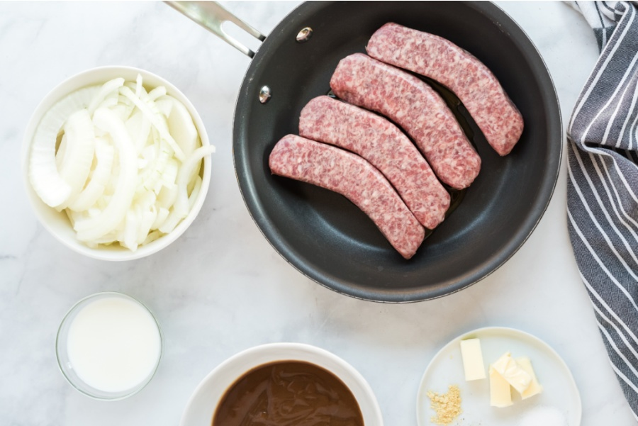 sausages cooking in a pan