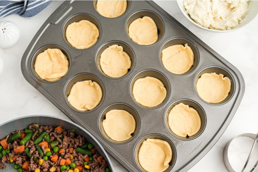 mini pie crusts in muffin tin openings