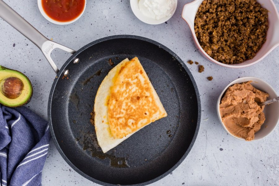 cooked quesadilla in a frying pan