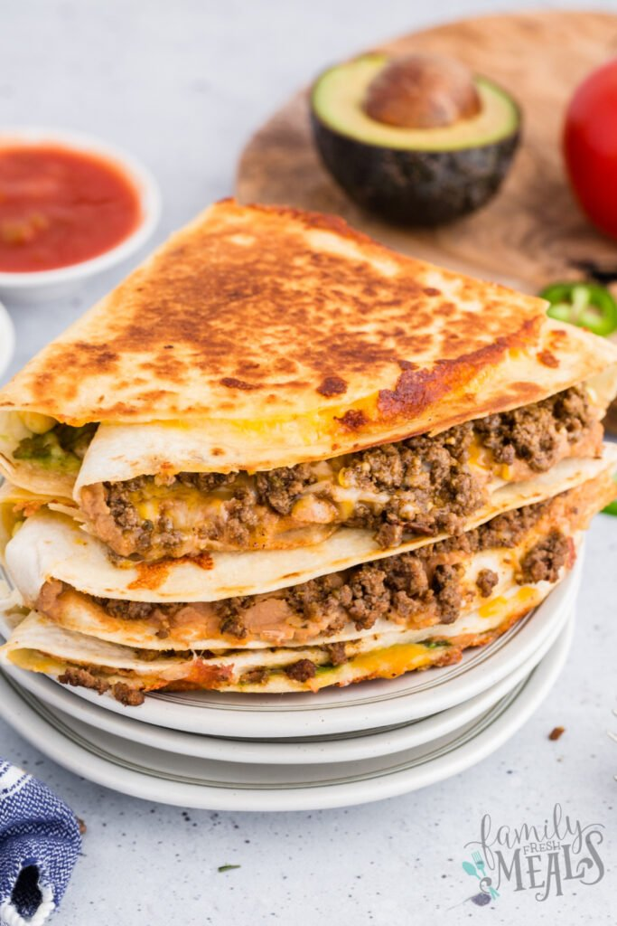 stack of quesadillas on plates