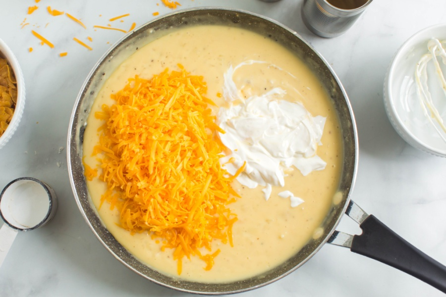 shredded cheese and sour cream added to pan