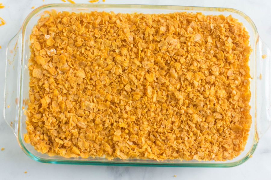 Classic Cheesy Funeral Potatoes in a glass baking dish