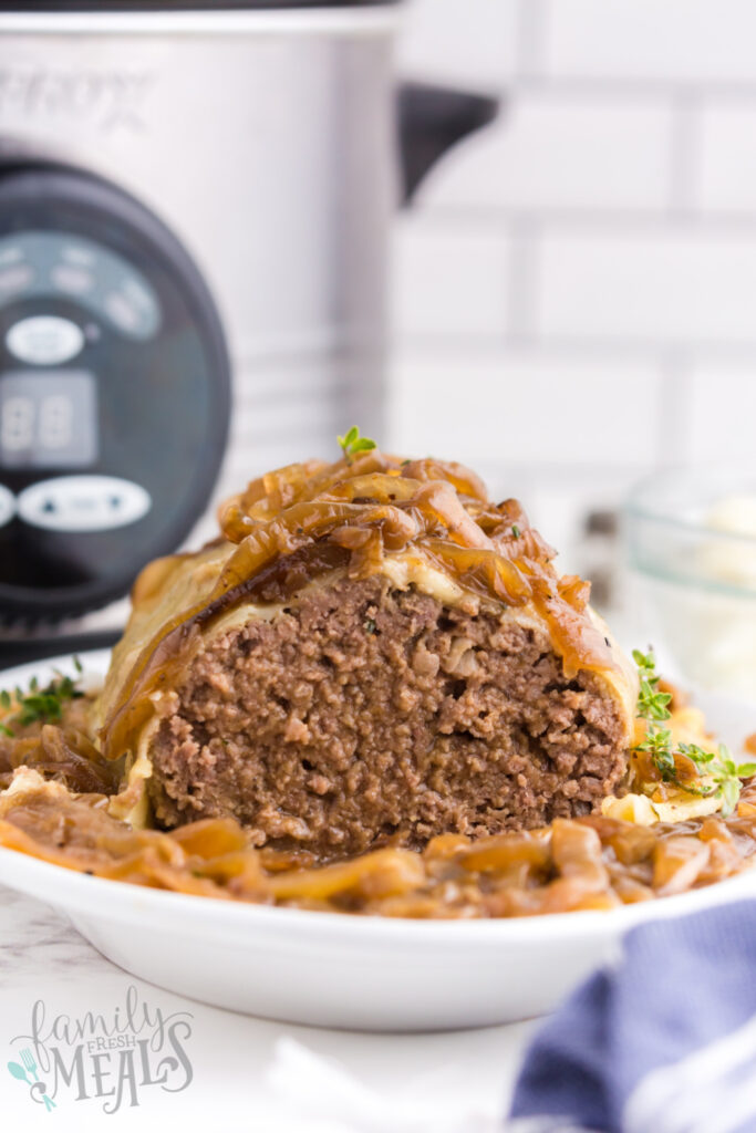 meatloaf on a serving platter with a slice removed