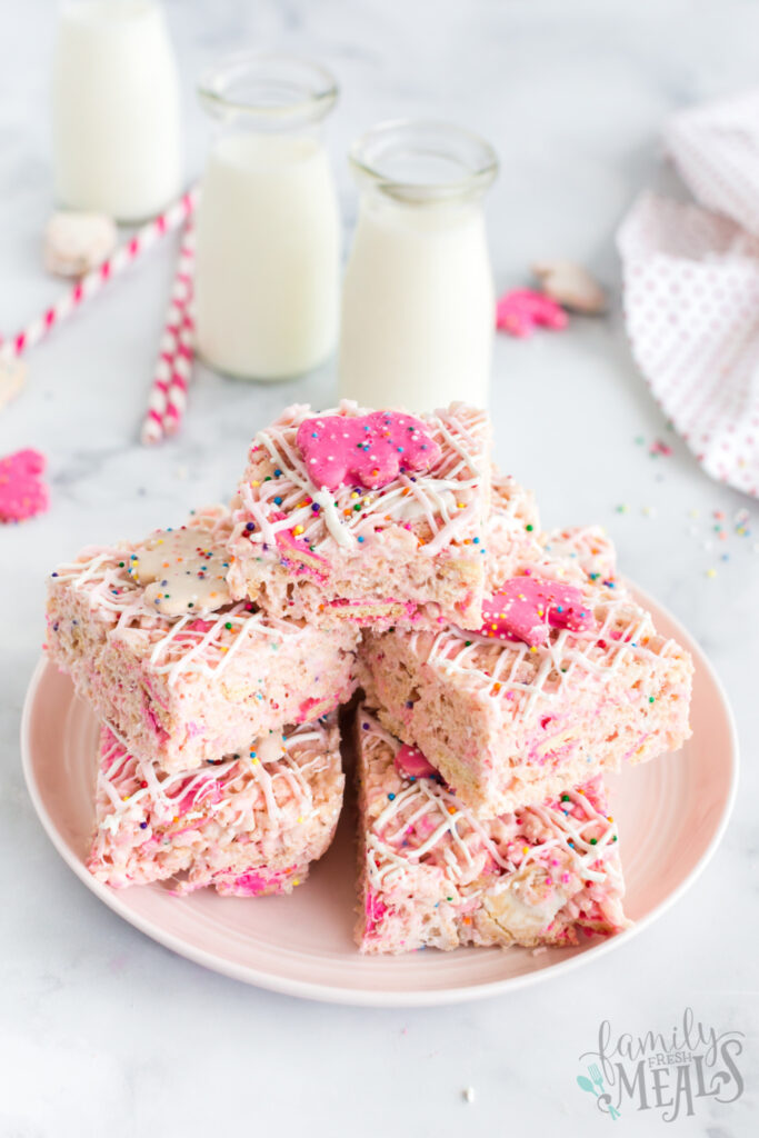 Circus Animal Cookie Rice Krispie Treats stacked on a white plate