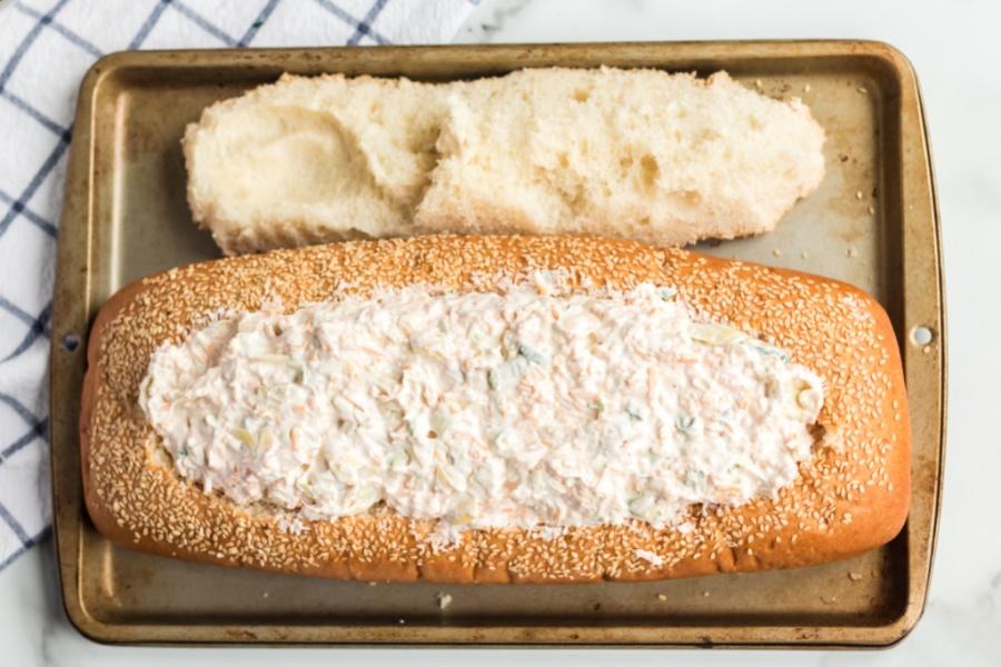 Mississippi Sin Dip inside loaf of bread, on a baking sheet