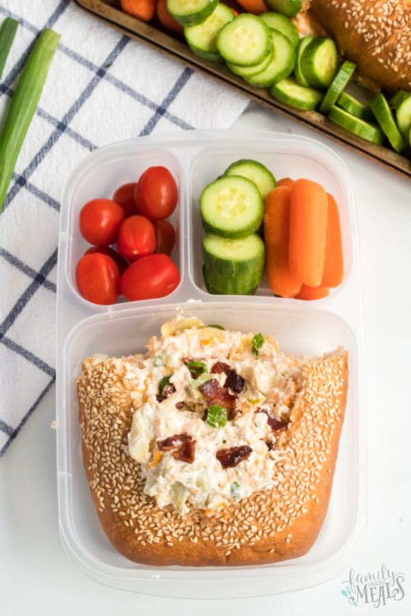dip packed in a lunchbox with vegetables