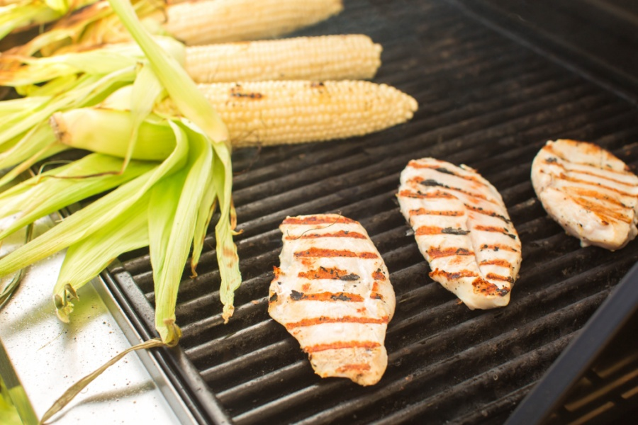 chicken and corn on a bbq grill