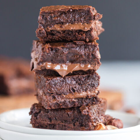 Nutella Stuffed Brownies stacked on a plate