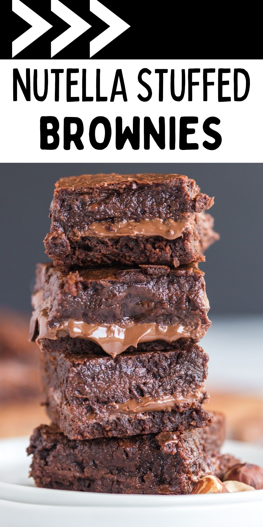 These Nutella Stuffed Brownies are soft brownies with a layer of chocolate-hazelnut magic. It's seriously swoon-worthy. via @familyfresh