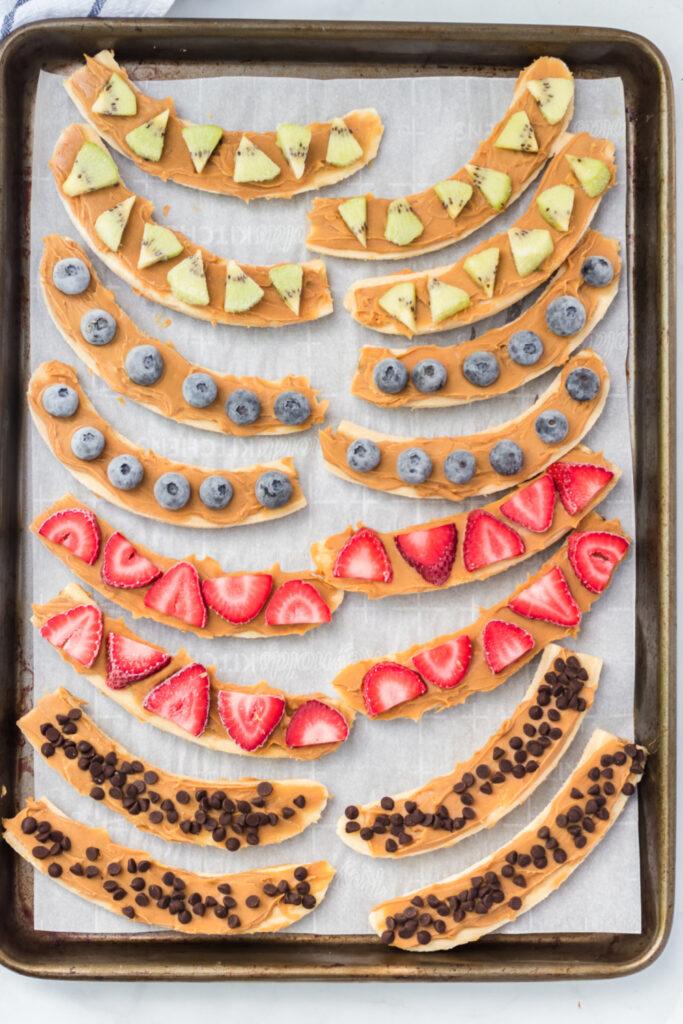 Healthy Frozen Banana Treats on a lined baking sheet