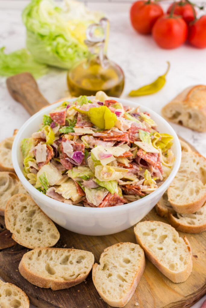 Italian Hoagie Dip in a bowl with sliced baguettes