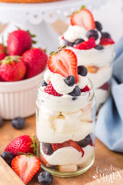 3 mason jar July 4th Angel Food Cake Trifle with a bowl of berries