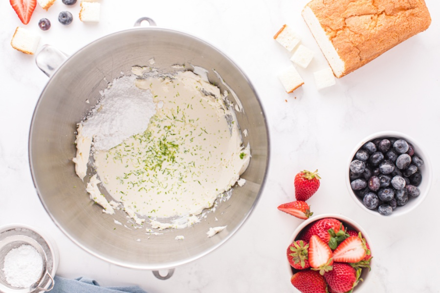heavy cream, powdered sugar, honey, lime juice, and lime zest added to the mixing bowl