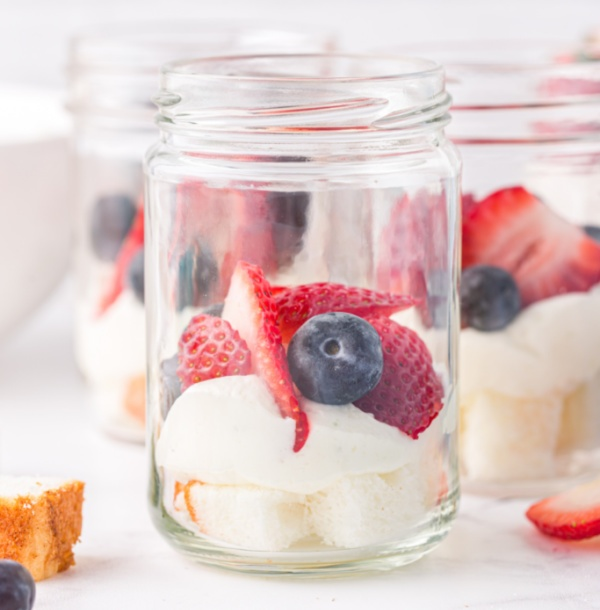 angel food cake cubes, cream cheese mix and berries in a mason jar