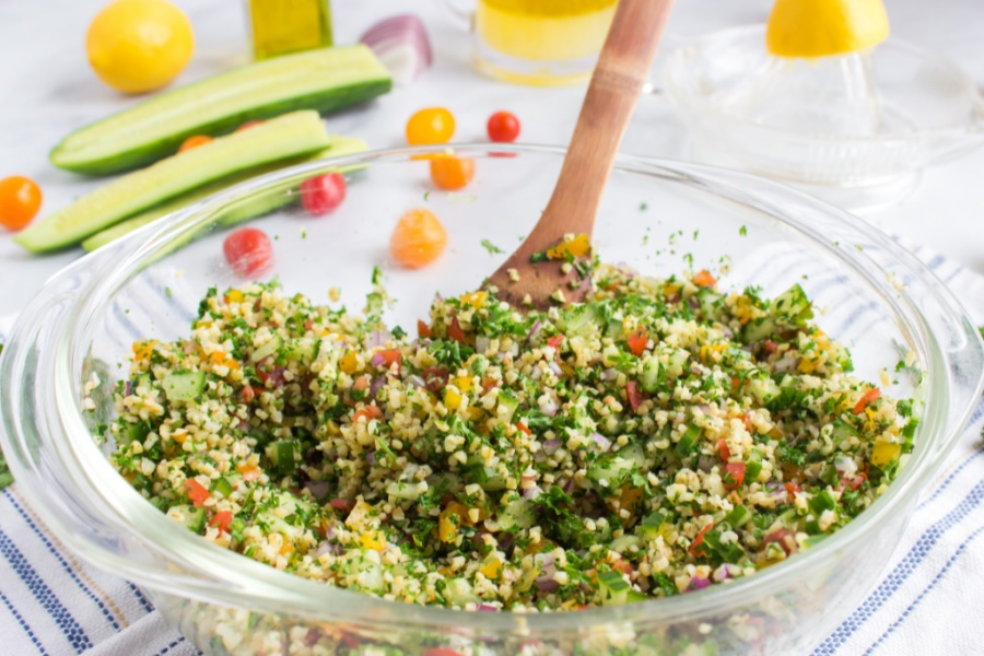 mixing Tabouli Salad in a bowl