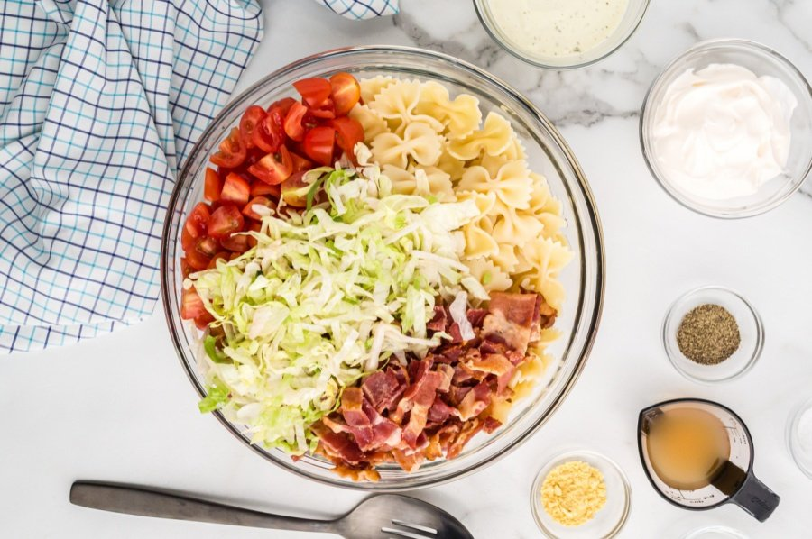 ingredients for blt pasta salad in mixing bowl