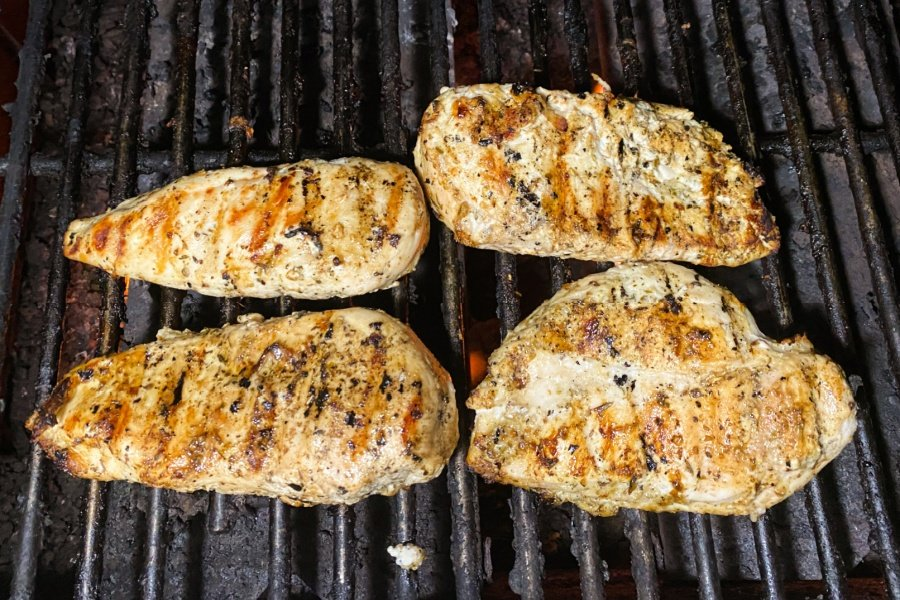 4 chicken breasts on a grill