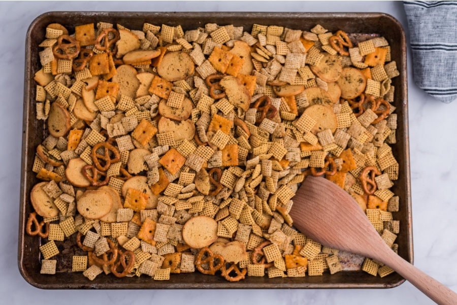 Dill pickle chex mix on a baking sheet