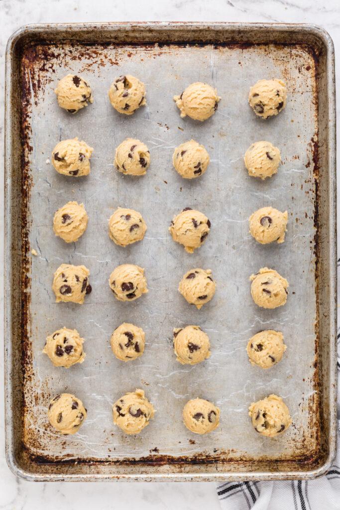 Cookie dough balls on a baking sheet