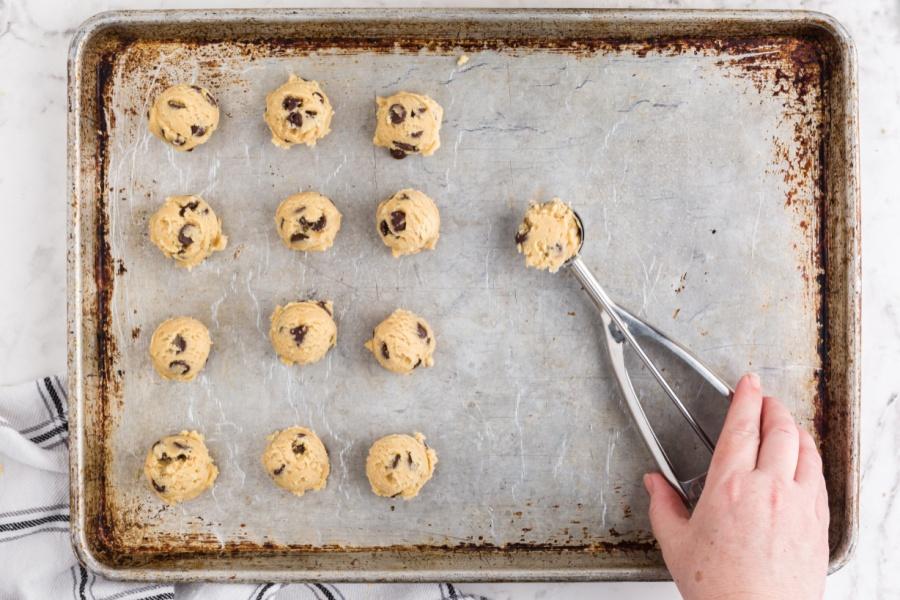 placing cookie dough balls on baking sheet