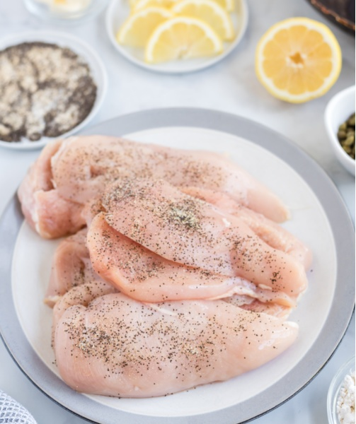 chicken breasts on plate with seasoning