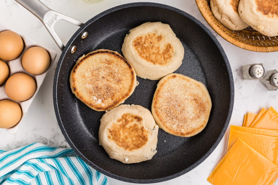 4 english muffins in a pan