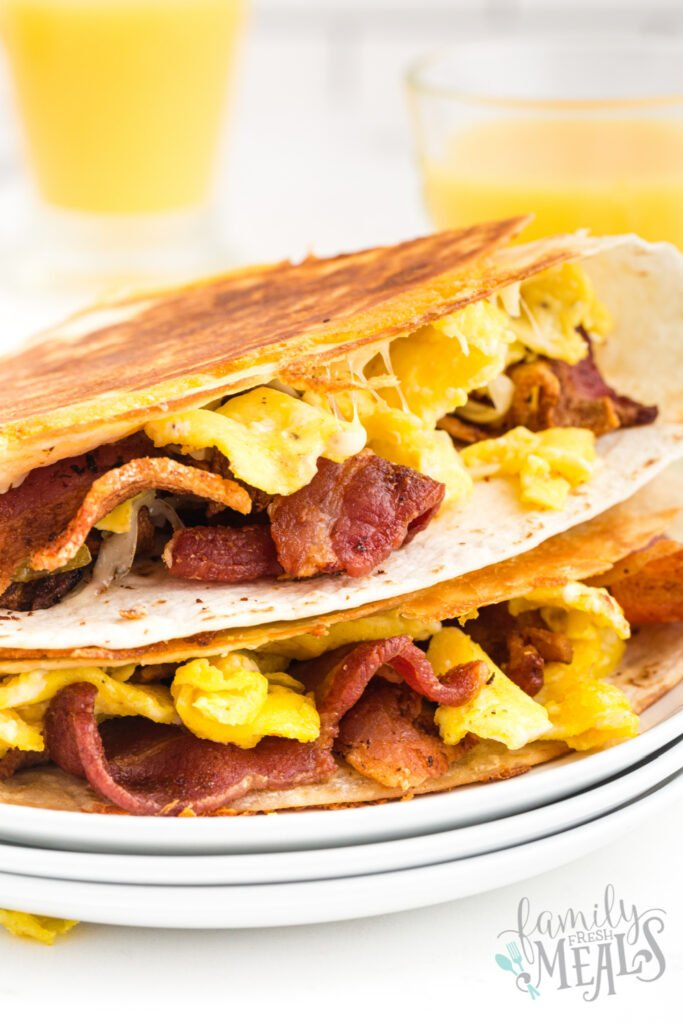 2 breakfast quesadillas stacked on a plate