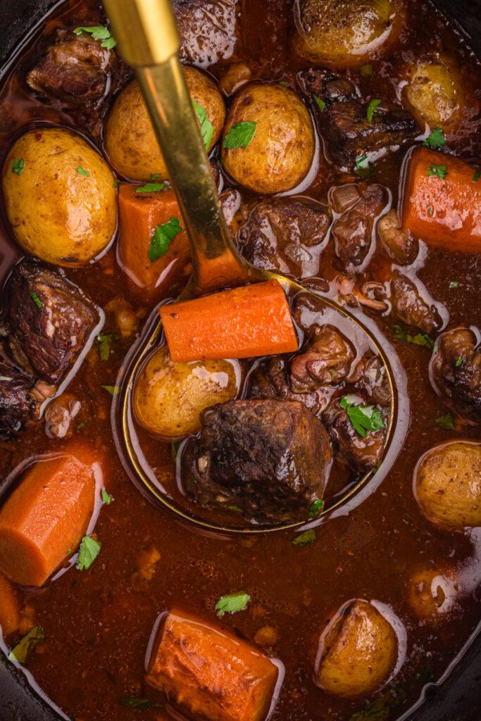 ladle scooping up Crockpot Beef Bourguignon