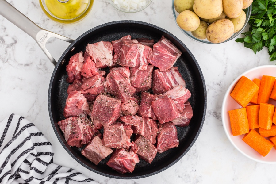 chunks of beef in a pan