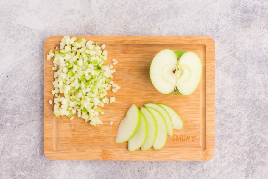 green apple chopped up on a cutting board