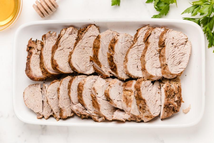 sliced pork on a serving platter
