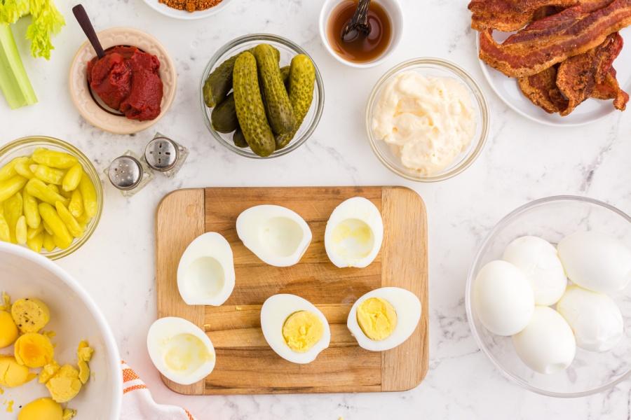 hard boiled eggs cut in half on cutting board
