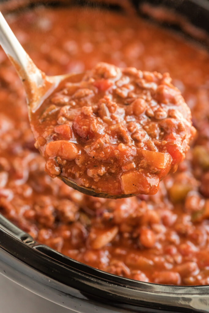 A ladle scooping up some Crockpot Chili Con Carne