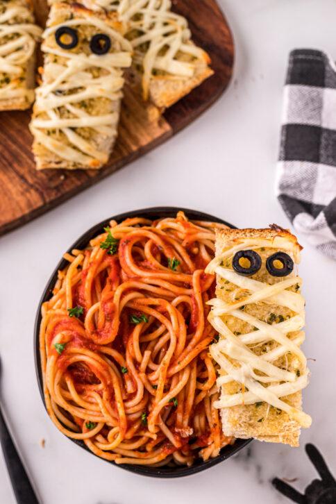 Mummy garlic bread in a bowl of spaghetti